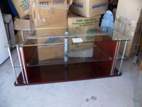 Tv stand top and middle are glass and the bottom is