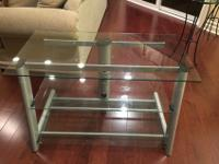 TV stand, silver base and 3 glass shelves, $90.00 or