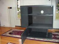 "HT 29"" , WID 28"" , DEPTH 16"" HAS STORAGE FOR DVD 'S ON"