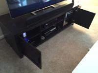 We are selling our TV stand since we are downsizing our