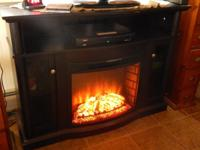 Plesant Hearth TV Stand with Electric Fireplace. Holds