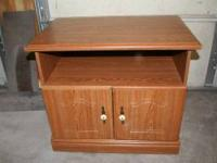 "TV stand with wheels. Good condition. 32"" x 19 3/4"". 27"