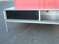 TV Table for sale $20 Gray color with sliding glass
