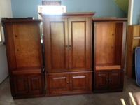Three piece armoire unit. middle section has space for