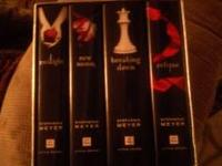 All 4 twilight books with box, box is alittle damaged