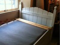 Girls twin bed looks like a picket fence. The side