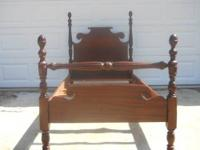 This is a solid wood ,exceptionally sturdy bed. Made in