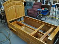 Twin bed by Broyhill with underbed drawers and shelf.
