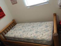 Twin size bed with wooden frame only used one year