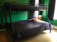 Black frame twin over full bunk bed.  Includes