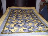 Twin size quilt. Top hand made and quilted together