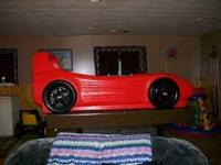 TWIN SIZE LITTLE TIKES RED CAR BED BED IS IN GREAT