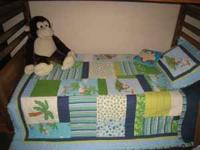 Twin size monkey bedding set. Includes 1 quilt, 1 flat