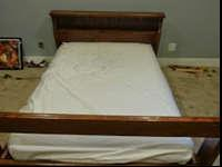 I'm selling a used twin size solid wood bed frame. My