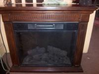 This is a electric fire place wood you can control the