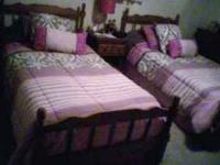 Twin beds with good solid mattresses and box springs -