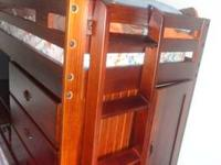 This dark brown, honey pine, twin-size loft bed is in