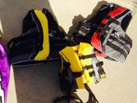 For sale two adult ski vest and one child vest. Also