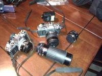 Two Good working cannon 35mm cameras. comes with case,