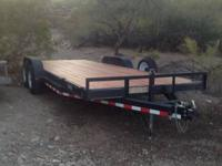 Two trailers for sale, made by Load Trail. Both are