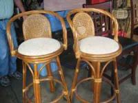 Two matching bamboo bar stools with cloth swivel seats,