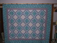 I have for sale two beautiful new home made quilts.