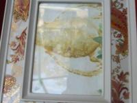 TWO BURNISHED AMBER PORCELAIN PICTURE FRAMES, BY LENOX.