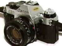 Selling two Canon AE-1 cameras, one with a 50mm lens,