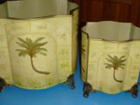 Two really charming metal containers. They have really