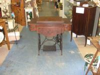 This is a great antique sewing machine and cabinet in