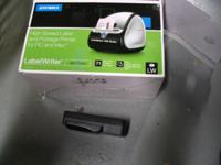 Two Dymo label makers with instruction manuals,