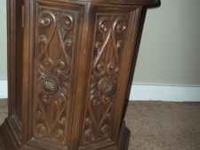Two dark brown circle wooded end table for sale. We
