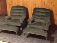 Two hunter green recliners in excellent condition. $100