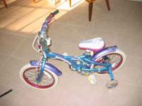 two Kids bikes , one Schwinn with training wheels and