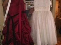two little girl flower dresses. The white one is a size