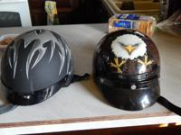 Two nice motorcycle helmets.  Both soze