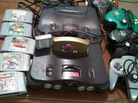 Both n64s work one has cords which is smoke gray AGAIN