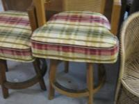 2 oak barstools with kind of a nation look. Walking