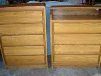 Two solid oak chest of drawers. The first has 5 drawers