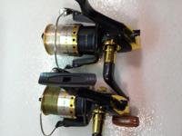 A pair of Black Beauty 2 spinning rods and reels and a