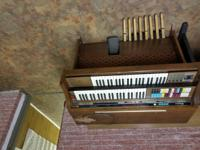 One piano is a portable Yamaha keyboard have stand and