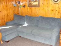 New condition two piece couch blue in color 275. OBO