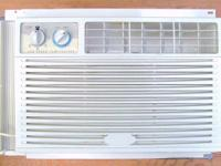Two portable Crosley room size air conditioners.  Both