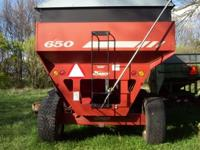 2-Red Demco 650 grain wagons. Both have roll tarps.