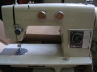 Signature Zig-Zag sewing machine with manual and 2