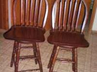 "Two solid cherry Swivel Bar Chairs. 24"" inch high."