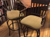 Beautiful, sturdy, swivel stools with arm rests and