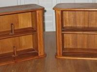 This sale includes two teak CD cases. The doors slide