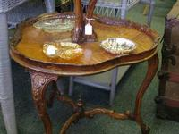 I have a beautiful Antique Two Tier Clover Leaf Table.