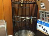 A like new two tiered cast iron bird cage. 6 ft tall x